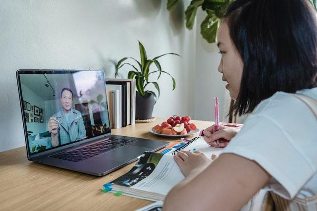 A girl attending an online course